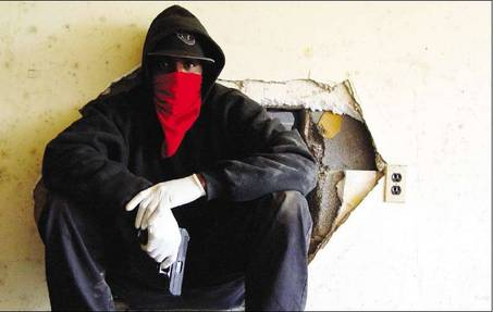Bloods gang member with gun