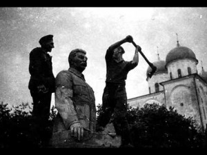 Destroying Stalin's statue