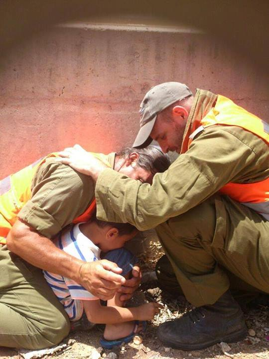 IDF soldiers protecting a child with their bodies