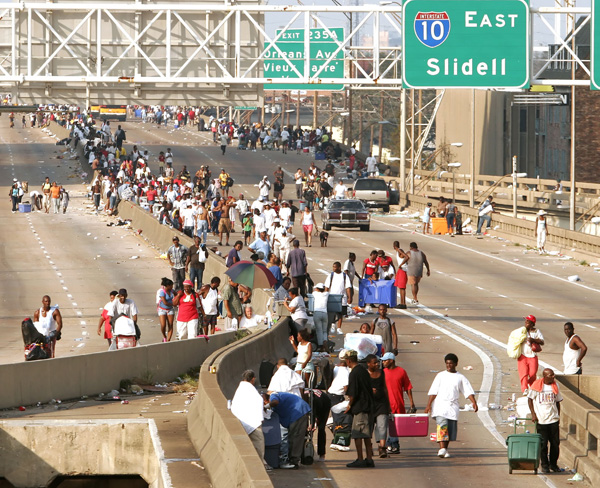 Hurricane Katrina victims, lacking any resources, clog New Orleans freeways.
